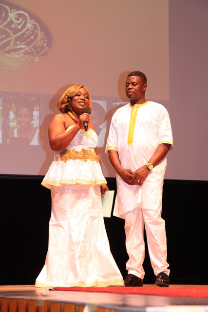 Mr and Mrs Davis on stage dressed in White African attire